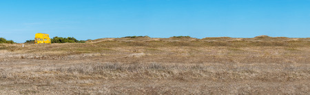 French landscape - Bretagne. Yellow double-decker bus in dunes at a sunny day. Stockfoto