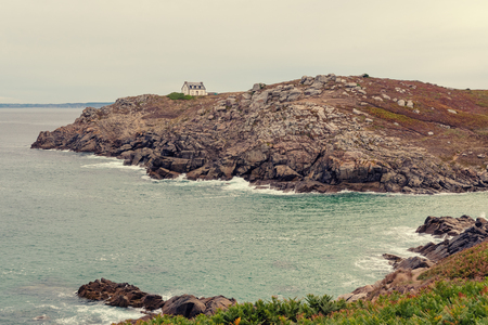 French landscape - Bretagne. Beautiful rocky coast with lighthouse and view over the sea.