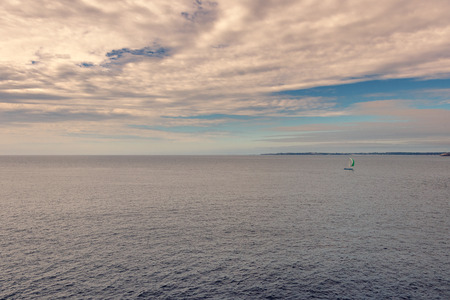 French landscape - Alone. A small sail boat in the evening on the way home.