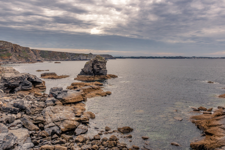 French landscape - Bretagne. Rocky coast with wild cliffs in the background.