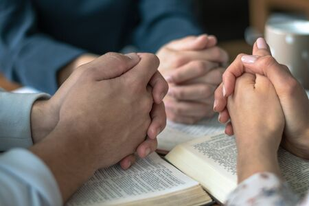 Christian worship and praise. Happy friends reading the bible together.