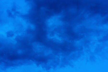 Blue hour sky clouds background. Beautiful landscape with stormy clouds and purple sun on sky