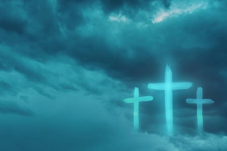 Christian worship and praise. Cloudy sky with three crosses and empty space.