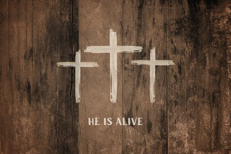 Christian worship and praise. Three crosses with wooden background and watercolor style. Text HE IS ALIVE Reklamní fotografie
