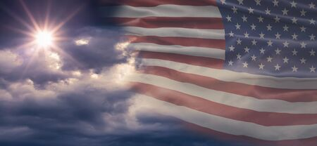 American National Holiday. Cloudy background with American flag and national colors. Copy space.