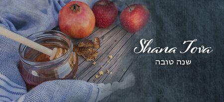 Jewish National Holiday. Rosh Hashana with honey, apple and pomegranate on wooden table. Text: Shana Tova