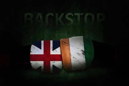 Political relationships. Irish and British Flag on boxing gloves. Partnership and conflicts. Backstop.