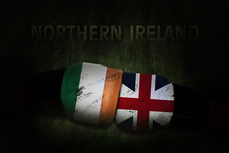 Political relationships. Irish and British Flag on boxing gloves. Partnership and conflicts. Northern Ireland. Zdjęcie Seryjne