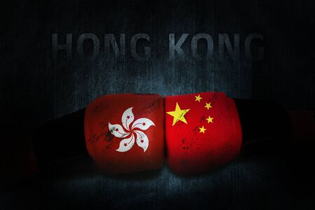 Political relationships. Hong Kong and Chinese Flag on boxing gloves. Partnership and conflicts. Hong Kong demonstration.