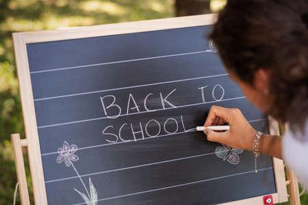 Back to School. Back to School written on classroom chalkboard by teacher. 免版税图像