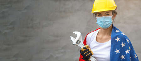 Woman work power. Portrait of female worker with face mask and US flag. Authentic close-up shot. Labor day.