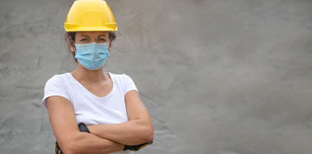Woman work power. Portrait of female worker with face mask. Authentic close-up shot. Labor day. 免版税图像