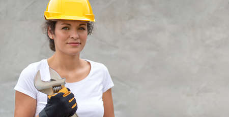 Woman work power. Portrait of female worker. Authentic close-up shot. Labor day.