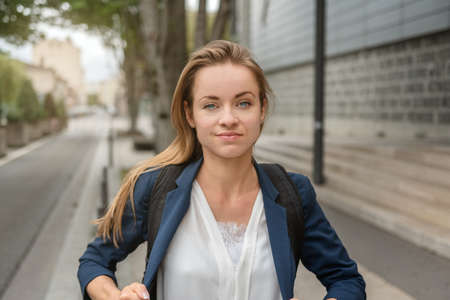 Urban city lifestyle. Young, smart, intelligent, friendly and likable portrait of an business woman manager outdoors.
