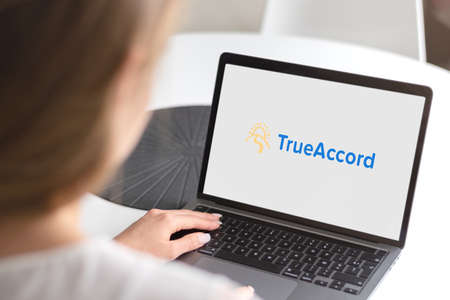 Guilherand-Granges, France - October 21, 2020. Notebook with TrueAccord logo. American company providing software to collect debts.