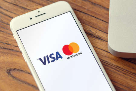 Guilherand-Granges, France - October 09, 2020. Smartphone with Visa and Mastercard logo. Multinational financial services cooperations. Credit cards. Online payment services. Stok Fotoğraf - 158370351
