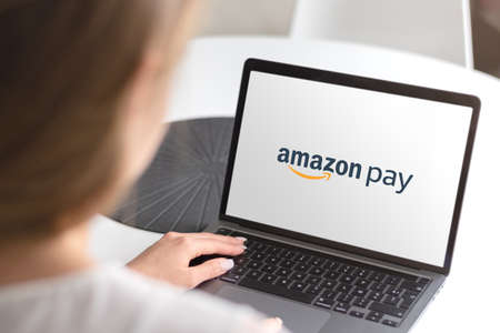 Guilherand-Granges, France - October 08, 2020. Notebook with Amazon Pay logo. Online payments processing service. Stok Fotoğraf - 158370332