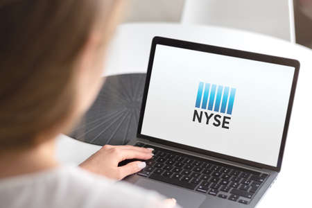 Guilherand-Granges, France - October 09, 2020. Notebook with New York Stock Exchange logo. World's largest stock exchange. Wall Street.
