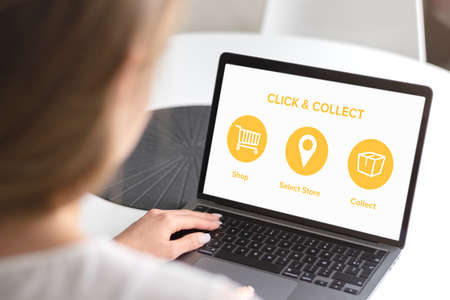 Click and Collect concept. Woman with laptop. E-commerce click and collect online ordering service symbol. Shopping bag. Shopping cart. Pickup location. Imagens