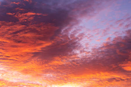 Backgrounds and textures. Beautiful and dramatic colorful sky with clouds at sunset. Sky texture. Abstract nature background.