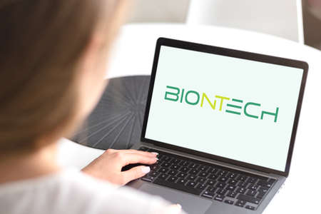 Guilherand-Granges, France - November 11, 2020. Notebook with Biontech logo. German biotechnology company dedicated to the development and manufacture of active immunotherapies. Editöryel