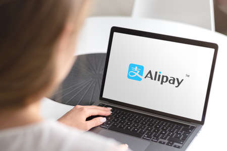 Guilherand-Granges, France - October 08, 2020. Notebook with Alipay logo. Chinese mobile and payment platform. Online money transfers. Editöryel
