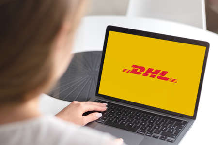 Guilherand-Granges, France - November 24, 2020. Notebook with DHL logo. German courier, parcel, and express mail service. Editöryel