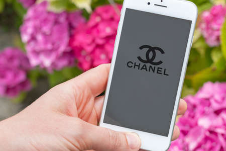 Guilherand-Granges, France - October 07, 2020. Person holding smartphone with Chanel logo. Chanel is a French fashion house and luxury goods company.