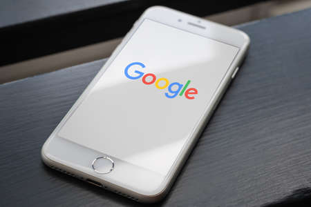 Guilherand-Granges, France - June 16, 2020. Smartphone with Google logo. Internet-related services and products. Search engine, cloud computing.