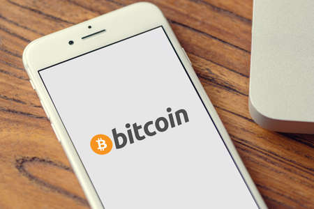 Guilherand-Granges, France - October 09, 2020. Smartphone with Bitcoin logo. Cryptocurrency. Decentralized digital currency.