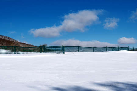 French winter landscapes. Panoramic view of mountain peaks and canyons. Vercors Regional Natural Park. Snow protection net or grid. Foto de archivo