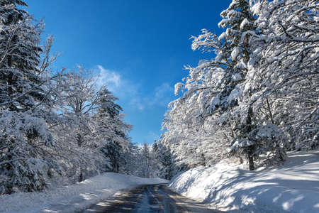 French winter landscapes. Snowy and icy mountain road. Vercors Regional Natural Park.