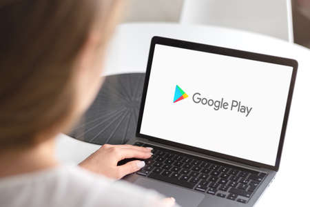 Guilherand-Granges, France - February 16, 2021. Notebook with Google Play app logo.  Digital distribution service operated and developed by Google.