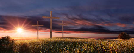 Three crosses in field by sunset. Imagens