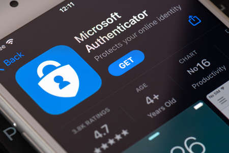 Guilherand-Granges, France - February 08, 2021. Smartphone with Microsoft Authenticator app logo. Two-factor authentication program that provides added security to your online accounts.