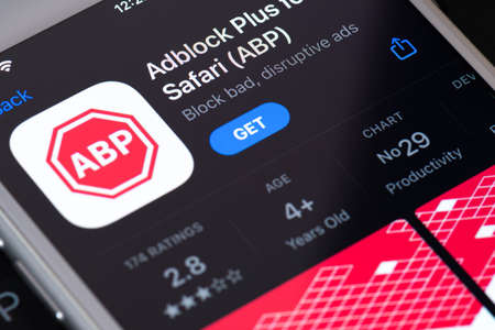 Guilherand-Granges, France - February 08, 2021. Smartphone with AdBlock Plus app logo. Open-source browser extension for content-filtering and ad blocking.