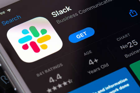 Guilherand-Granges, France - February 08, 2021. Smartphone with Slack app logo.  Proprietary business communication platform developed by American software company Slack Technologies. 新聞圖片