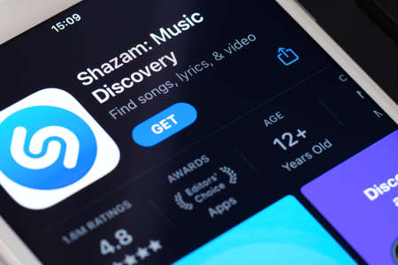 Guilherand-Granges, France - February 08, 2021. Smartphone with Shazam app logo. application that can identify music, movies, advertising, and television shows, based on a short sample played. 新聞圖片