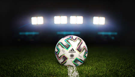 Guilherand-Granges, France - June 07, 2021. Official Adidas Football of Euro 2020 (in 2021) football tournament and official logo of UEFA. Stadium background.