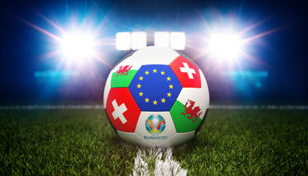 Guilherand-Granges, France - June 08, 2021. Football with national flags of Wales and Switzerland. Stadium in background. 3d rendering. 2020 Euro football tournament. Editoriali