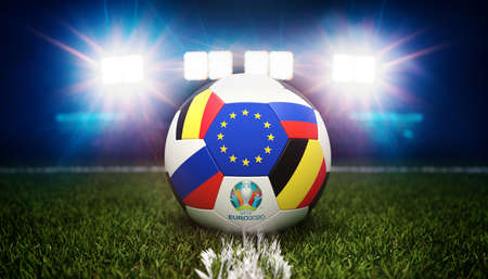 Guilherand-Granges, France - June 10, 2021. Football with national flags of Belgium and Russia. Stadium in background. 3d rendering. 2020 Euro football tournament.