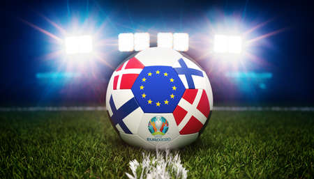 Guilherand-Granges, France - June 10, 2021. Football with national flags of Denmark and Finland. Stadium in background. 3d rendering. 2020 Euro football tournament.