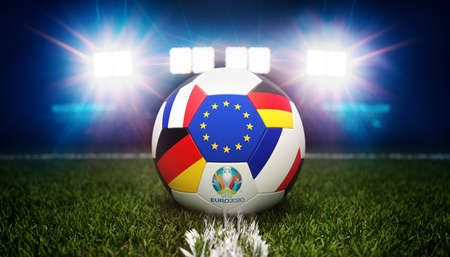 Guilherand-Granges, France - June 10, 2021. Football with national flags of France and Germany. Stadium in background. 3d rendering. 2020 Euro football tournament.