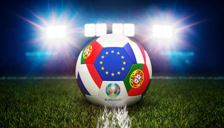 Guilherand-Granges, France - June 11, 2021. Football with national flags of Portugal and France. Stadium in background. 3d rendering. 2020 Euro football tournament.