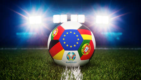 Guilherand-Granges, France - June 11, 2021. Football with national flags of Portugal and Germany. Stadium in background. 3d rendering. 2020 Euro football tournament. Editoriali