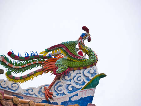 Bird statue on temple roof Stock Photo - 12767609