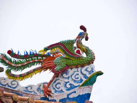 Bird statue on temple roof Stock Photo - 12767609