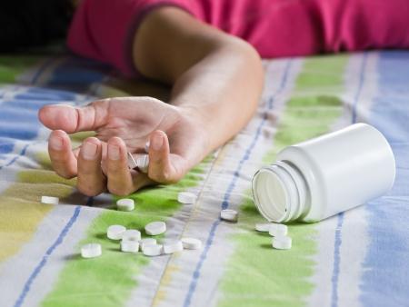 overdosering: Neem een overdosis Stockfoto