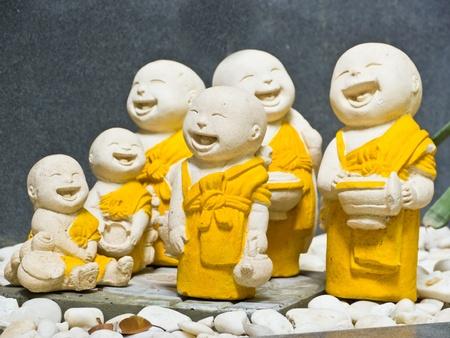 Statue of smiling novice