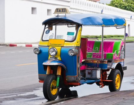 Three wheels taxi or well known in Tuk-Tuk in Thailand